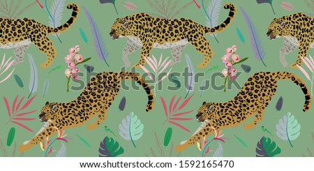 two leopards on a seaform green
