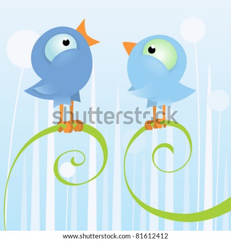 Two loving birds sitting on the branch
