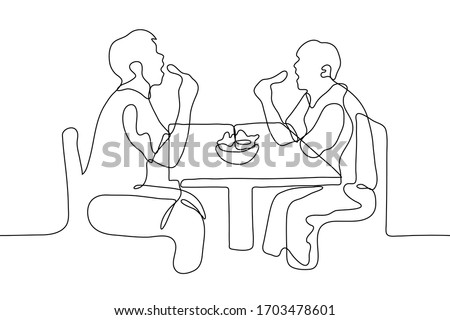 two men eat chicken legs at the table, their mouths are wide open they are sitting opposite each other between the guys a full plate of food. One continuous line drawing. Can be used for animation Stock photo ©