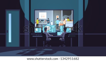 two men looking at monitors behind glass consultants provides expert advice to customers in modern technology store dark office interior surveillance security system flat horizontal