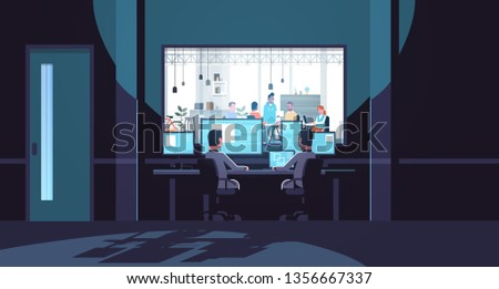 two men looking at monitors sitting behind glass window people working in co-working open space office center dark room interior surveillance security system flat horizontal