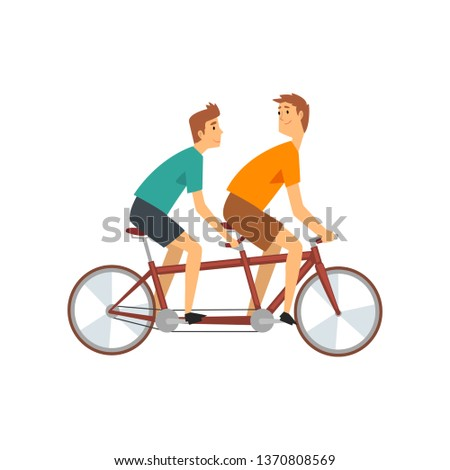 two men riding tandem bike
