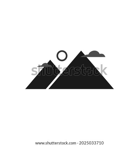 two mountains with clouds and