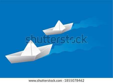 two paper boats sailing on the