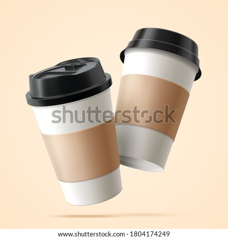 two paper coffee cups with