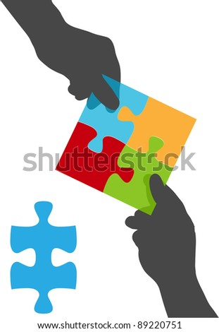 Two people collaborate on a solution to a four piece jigsaw puzzle business problem