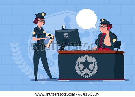 two police women working on