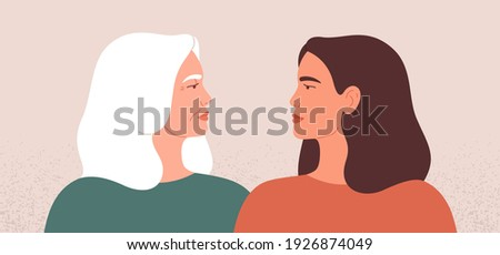 Two strong women look at each other. Side view of mature mother and her young daughter standing together. Female friendship or disagreement concept. Vector illustration.  Foto stock ©