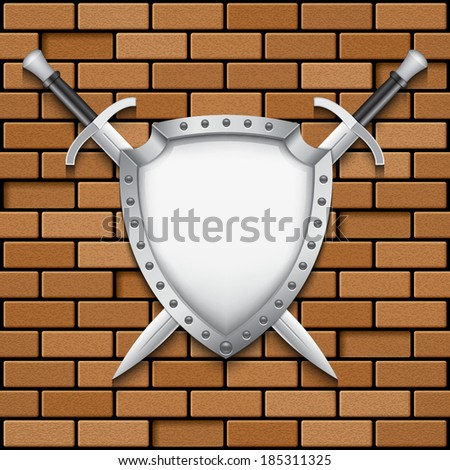 two swords and shield on brick