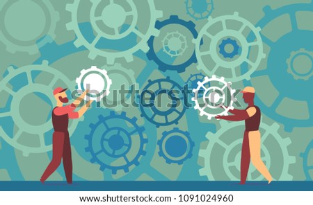Two technicians work on a big and complex mechanism