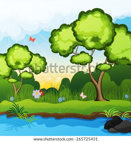 Two trees on the riverbank. Butterflies fly over the grass. spring landscape