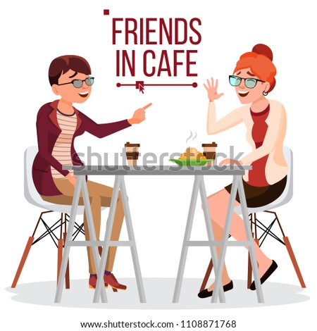 two woman friends drinking