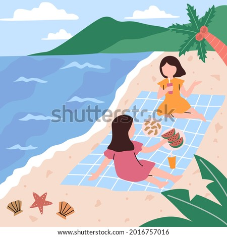 two woman having picnic on