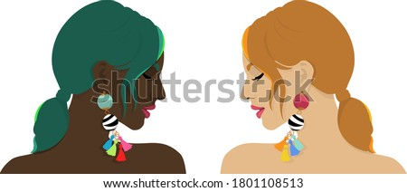 Two women different in their complexion but their beauty lies in their strength. Both are wearing colourful earrings. Portrays the strength and confidence of women regardless of shades and skin tones. Photo stock ©