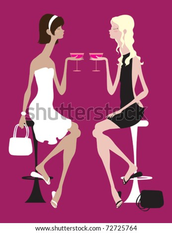 Two women enjoying a fancy drink together, cheers!