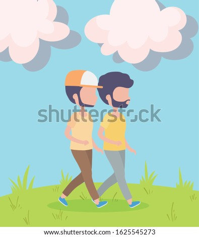 two young men walking in the