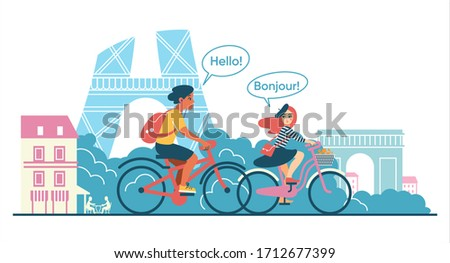 two young people ride bicycles