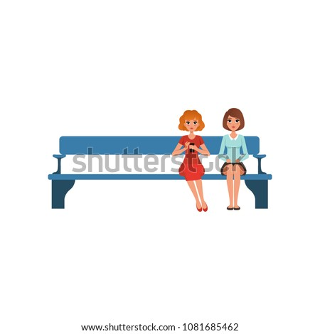 two young women sitting on