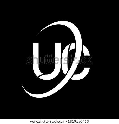 UC logo. U C design. White UC letter. UC/U C letter logo design. Initial letter UC linked circle uppercase monogram logo. Foto stock ©