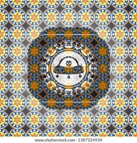 ufo with aline inside icon inside arabesque emblem background. arabic decoration.
