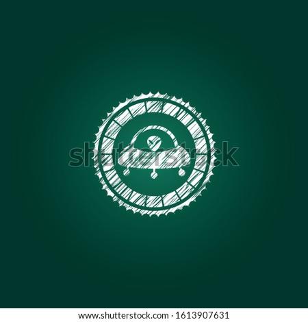 ufo with aline inside icon inside chalk emblem