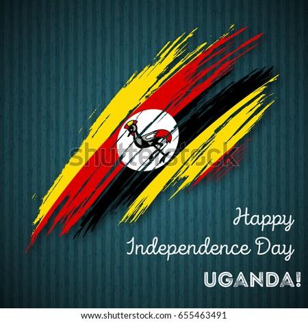 Shutterstock Uganda Independence Day Patriotic Design. Expressive Brush Stroke in National Flag Colors on dark striped background. Happy Independence Day Uganda Vector Greeting Card.