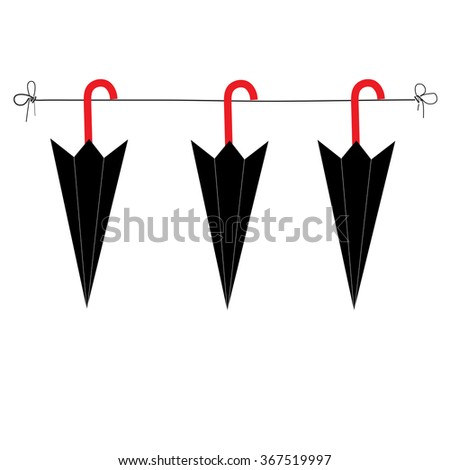 umbrellas hanging on rail rope