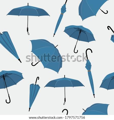 Umbrellas set in various shapes.  Blue umbrella seamless pattern. Stick umbrella.