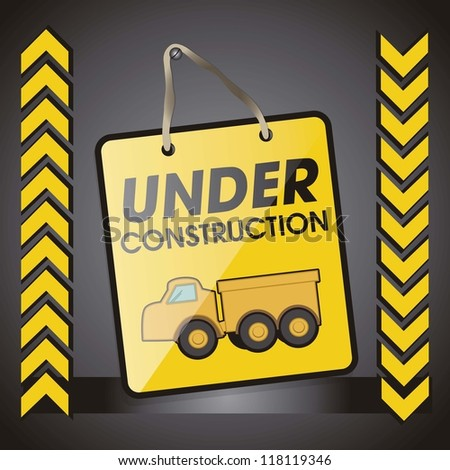 under construction banner and yellow truck