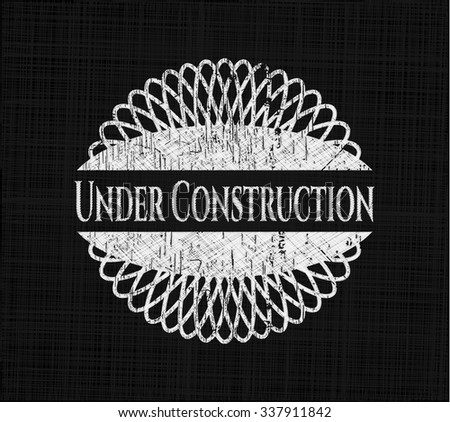 Under Construction chalk emblem written on a blackboard