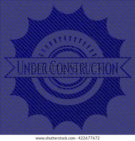 Under Construction emblem with denim high quality background