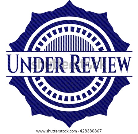 Under Review badge with jean texture