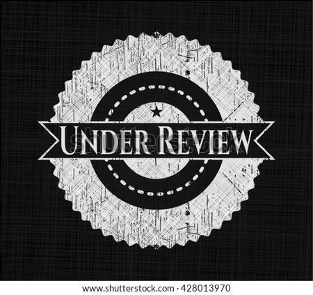 Under Review chalk emblem