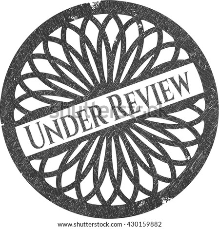 Under Review drawn with pencil strokes