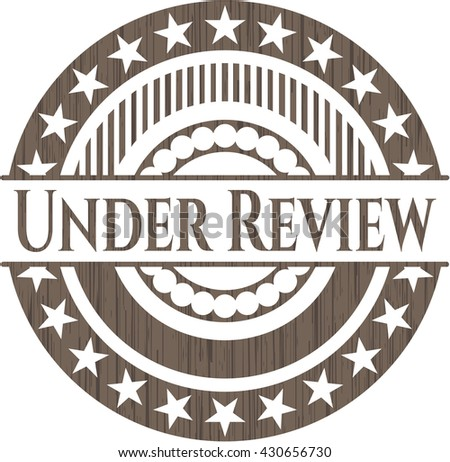 Under Review realistic wooden emblem
