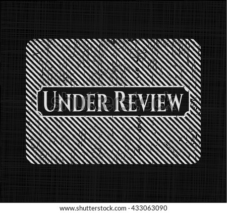 Under Review with chalkboard texture