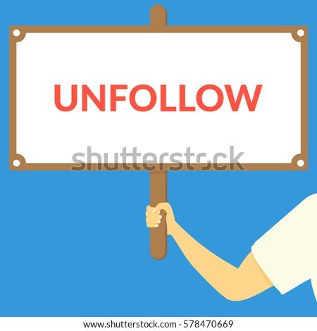 unfollow hand holding wooden