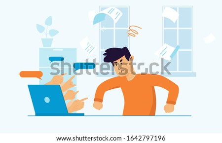 Upset angry man sitting at the desk struggling because of cyberbullying. Hands pointing out of laptop screen on social media shaming victim. Stop victim blaming online. Sad guy reading haters comments Сток-фото ©