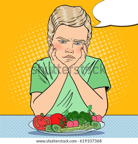 upset boy with plate of fresh...