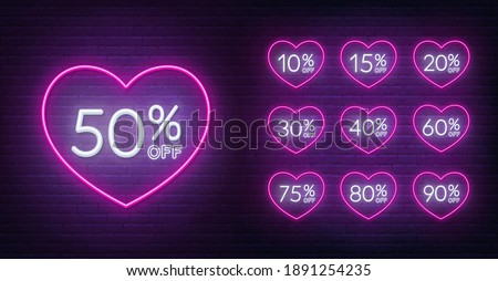 Valentine day discount neon design. 10, 15, 20, 30,40,50, 60, 75, 80, 90 percent off . Neon signs in a heart shape frame.
