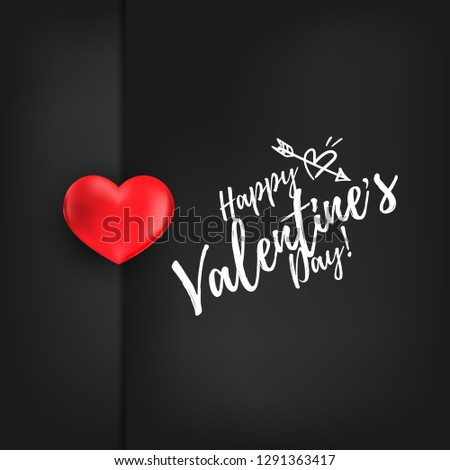 Valentine's Day background with beautiful red heart stick on black background with Happy valentine's Day text. Concept of love and valentine's day.
