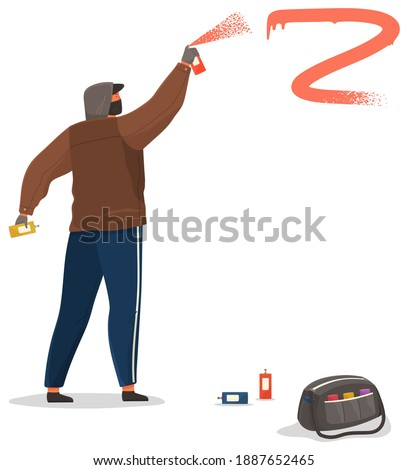 Vandal damaging. Bully in hood and balaclava painting graffiti. Street gangsters and vandalism concept. A man bandit destroy city property. Sprays paint from a balloon, spoils property Foto stock ©