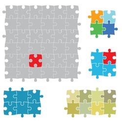 Various sizes puzzles, isolated on white background.