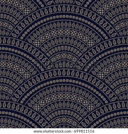 Vector abstract seamless scaly geometrical peacock tail pattern, metallic gold fan shaped ornate elements with ethnic pattern on a dark blue background. Wallpaper, textile print, batik, wrapping paper