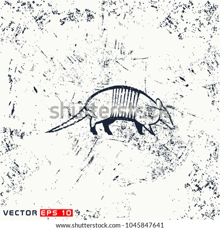 vector armadillo silhouette on grunge background
