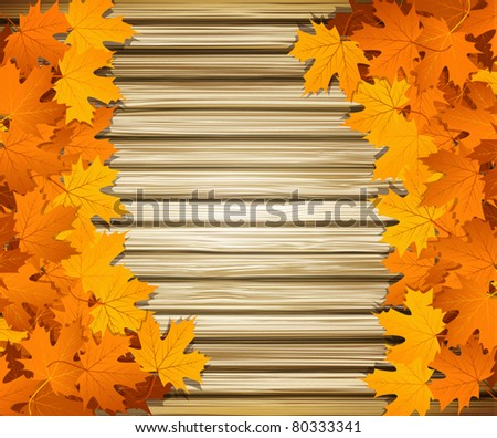 Vector autumn leaves on the background of a wooden wall