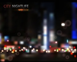 vector background of the night city with blurred lights