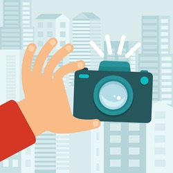 Vector camera in flat style - taking photo