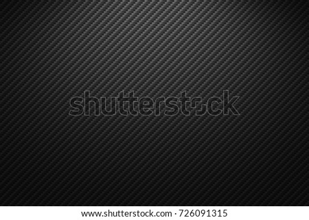 Vector carbon fiber texture. Dark background with lighting.