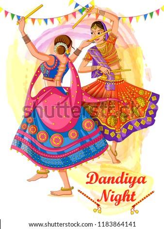 Vector design of Indian woman playing Garba in Dandiya Night Navratri Dussehra festival of India